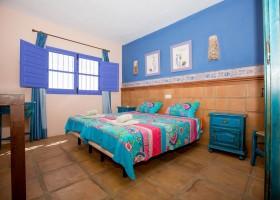 Hacienda Guaro Viejo slaapkamer 2 kamer appartement.jpg Hacienda Guaro Viejo 40plusteens